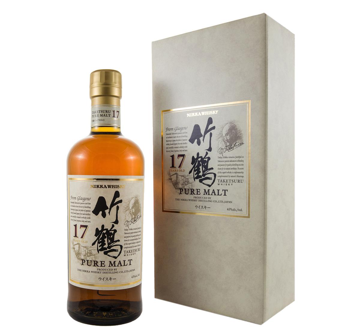Med gyllende detaljer ståtar Taketsuru 17yo bredvid sin kartong.